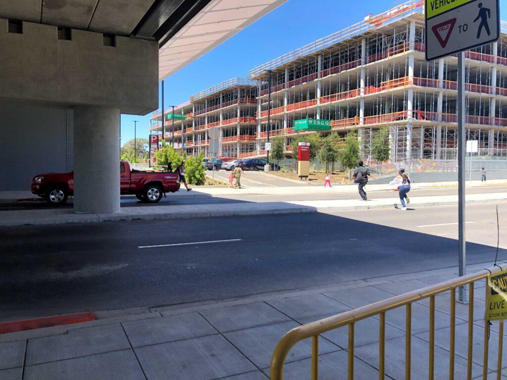 Pedestrians Running Across 28th Ave